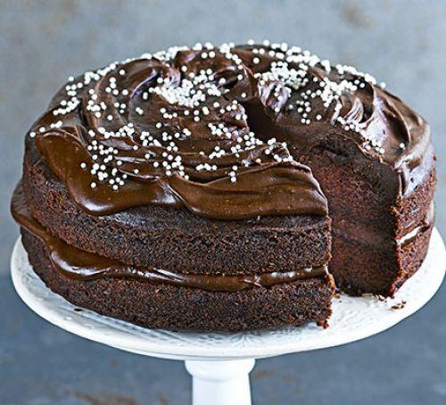 Chocolate avocado cake on cake stand