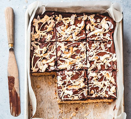 Double choc & coconut traybake cut into squares