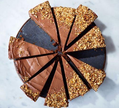 Chocolate hazelnut ice cream cheesecake slices topped with chopped hazelnuts
