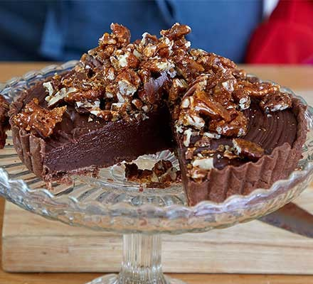 Sea-salted chocolate & pecan tart served on a cake stand