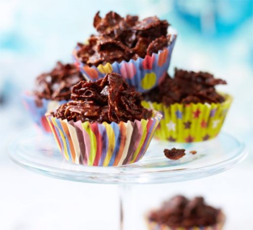 Chocolate cornflake cakes in colourful paper cases