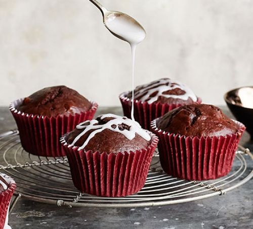 Four chocolate muffins in red paper cases