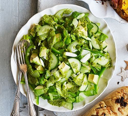 Plate of chopped green salad with cutlery