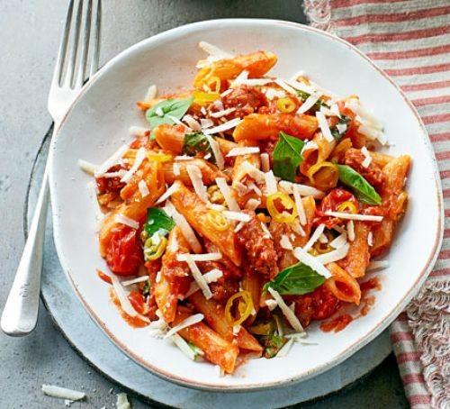 RIgatoni pasta in tomato and chorizo sauce, on a plate