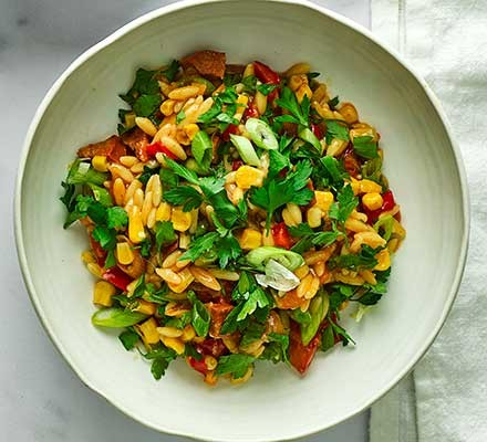 Chorizo, orzo & sweetcorn summer stew served in a bowl