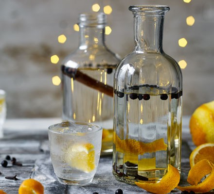 Gin in decanters with orange peel