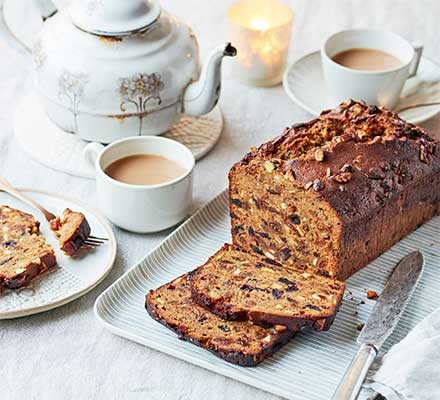 Last-minute Christmas loaf cake cut into slices and served with a cup of tea