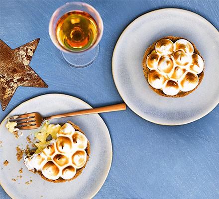 Christmas meringue pies served on plates