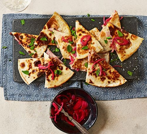 quesadilla topped with ham and sweet pickled onions