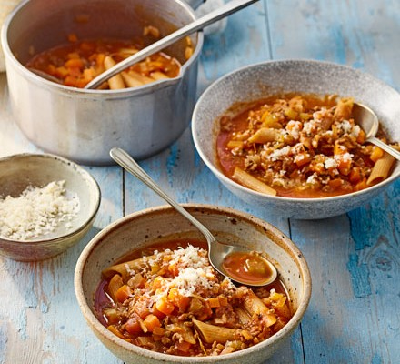 Bowls of Bolognese soup with penne