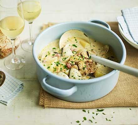 A casserole dish serving clam chowder