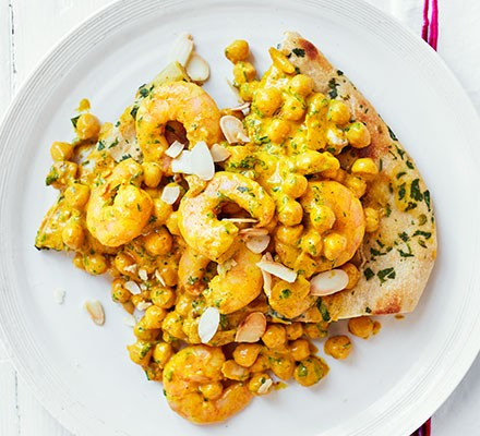 Coronation prawns & chickpeas served on toasted naan
