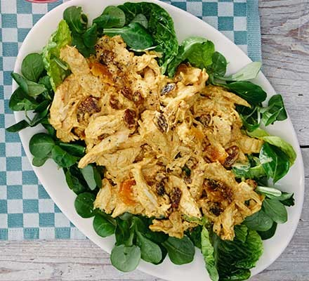 Easy coronation chicken served on a plate with salad
