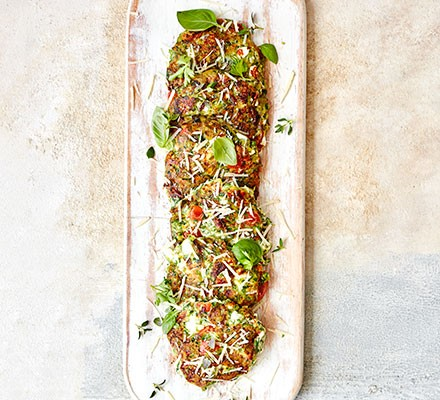 A column of cottage cheese fritters on a chopping board