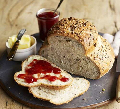 Cottage loaf with jam and butter