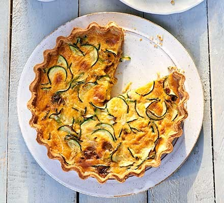 A plate serving courgette & double cheese quiche