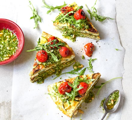 Courgette tortilla wedges with pesto & rocket