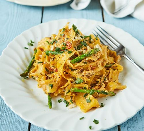 Crab and asparagus pappardelle on a plate