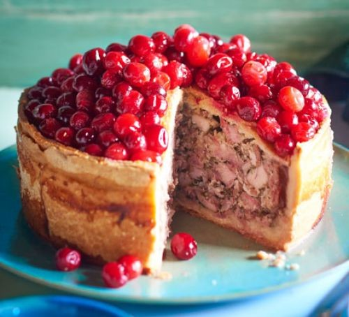 Raised pie topped with cranberries