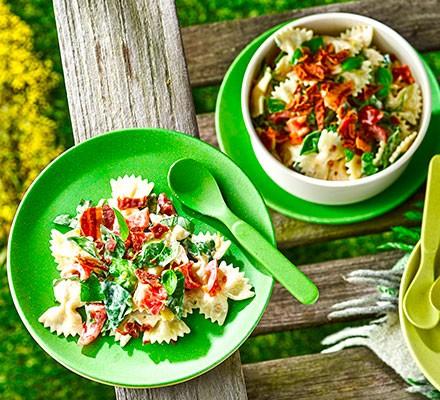 Creamy bacon & tomato pasta salad served on picnic plates