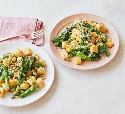 Two plates serving creamy broccoli gnocchi