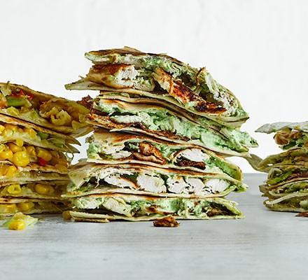 A stack of creamy garlic chicken quesadilla