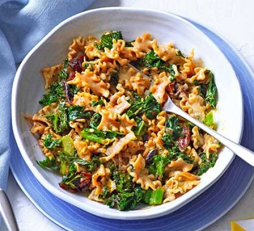 Pesto and kale pasta in a bowl