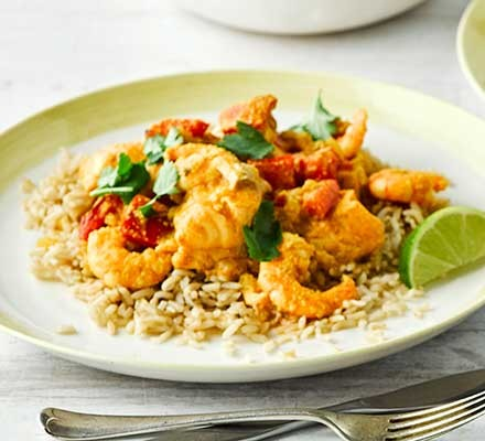 Creamy salmon, prawn & almond curry served with rice
