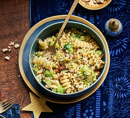 Creamy sprout, hazelnut & leek pasta served in a bowl
