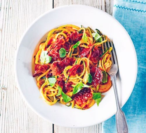 Creamy tomato and courgetti noodles in a bowl