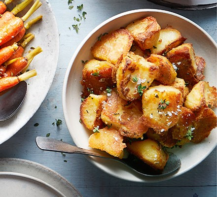 Crispiest ever roast potatoes served in a bowl