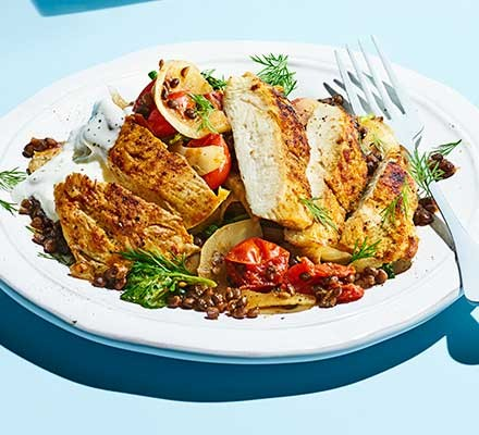 Paprika chicken with tomatoes & lentils served on a plate