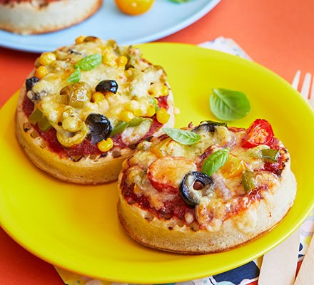 Two crumpet pizzas on a yellow plate