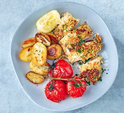 Breaded chicken slices with tomatoes and potatoes
