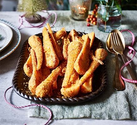 Crunchy parsnips served in a roasting dish