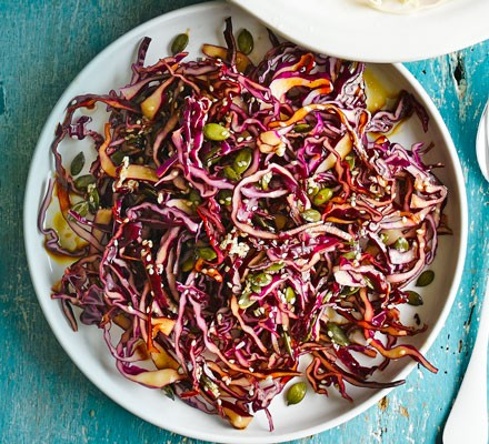Crunchy red cabbage slaw on a plate