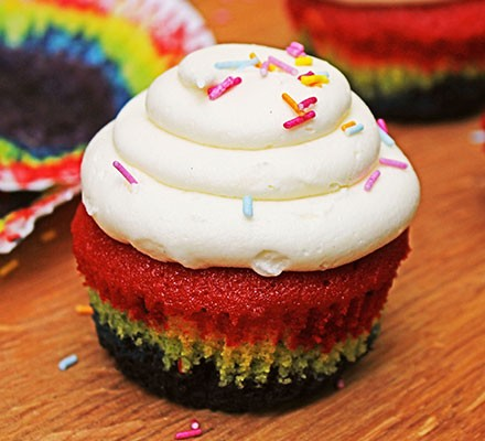 A single rainbow cupcake