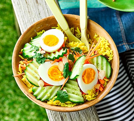 Curried rice & egg salad served in a wooden bowl