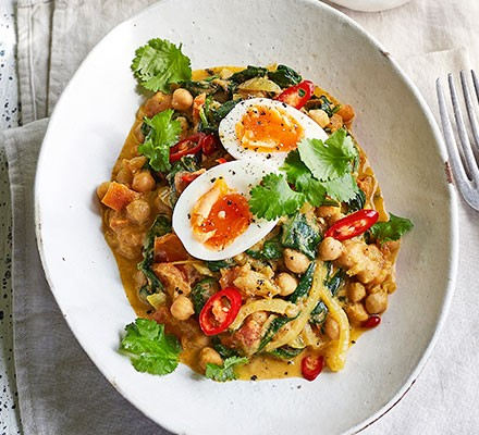 Curried spinach, eggs & chickpeas served on a plate