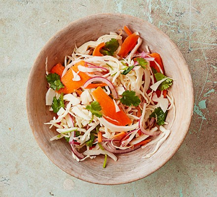 A bowl filled with Curtido – Mexican slaw