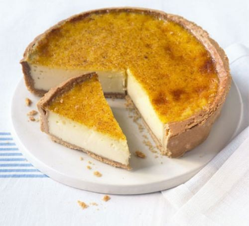 Custard tart with slice taken out on a plate