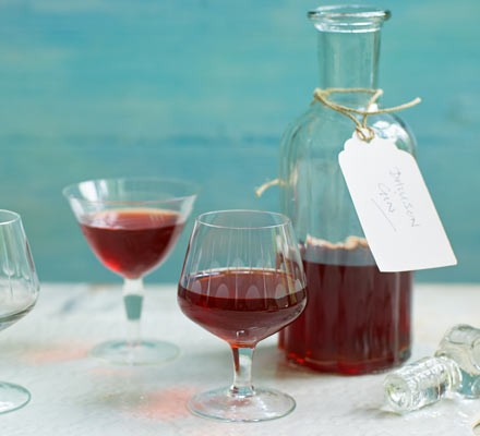 Damson gin in glasses and decanter with label