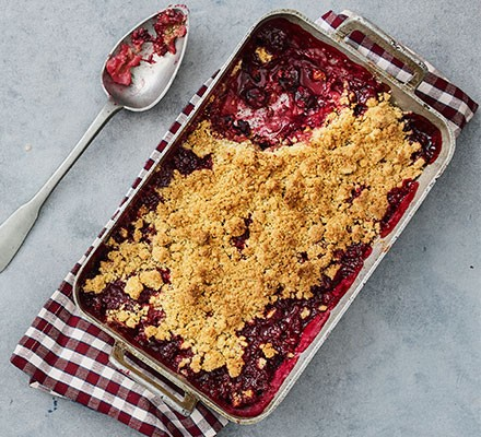 Damson crumble served in a dish