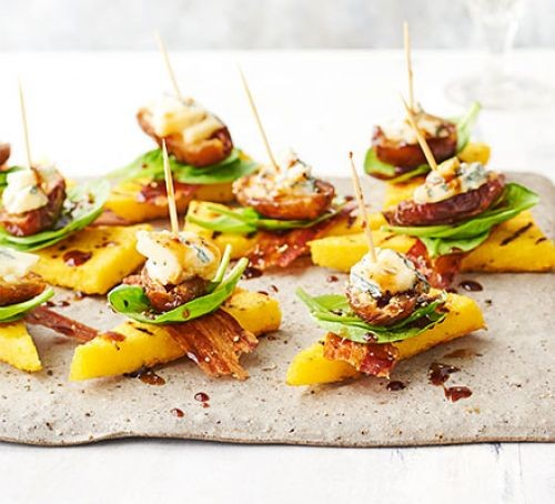 Date, blue cheese, pancetta and polenta stacks on cocktail sticks