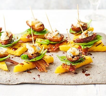 A selection of date, blue cheese & pancetta polenta stacks on a serving tray