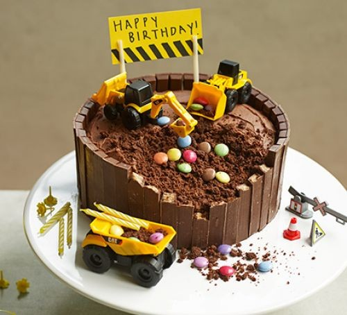 Chocolate cake topped with digger toys