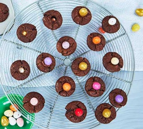 Mini brownies topped with colourful chocolate eggs