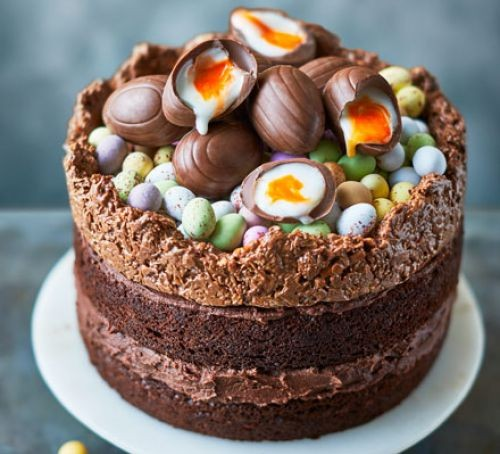 Chocolate cake topped with creme eggs and mini chocolate eggs