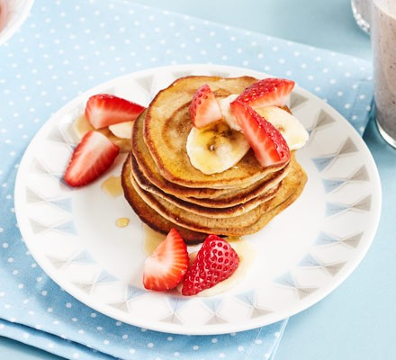 Pancake stack on plate with fruit