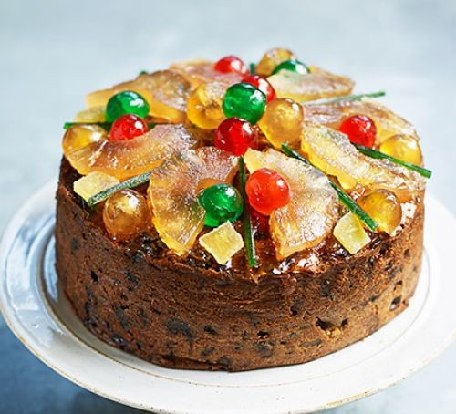 Easy-peasy fruitcake topped with candied fruit, served on a plate